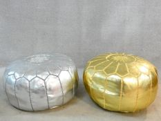 A pair of North African inspired pouffes in gilt and silvered faux leather. H.34 W.50 D.50cm