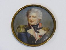 A 19th century signed miniature portrait of a naval officer in uniform, painted on ivory, in gilt