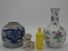 A Chinese blanc de chine Dog of Fo, a Chinese blue and white ginger jar (lacks lid), a floral