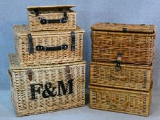A set of three graduating wicker hamper baskets, one with Fortnum and Mason logo along with three