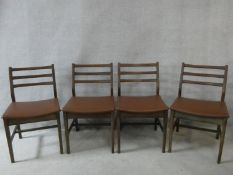 A set of four vintage teak dining chairs. H.78cm