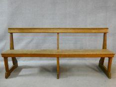 A vintage jointed oak hall seat on platform feet. H.82 W.183 D.50cm