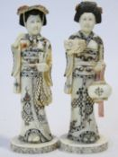 Two C.1900 Japanese carved bone geisha figures, engraved and painted, one carrying a lantern. H.20cm
