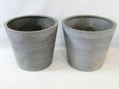 A pair of large faux stoneware garden planters. 59x68cm