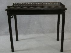 A mahogany Georgian style silver table with galleried top on square chamfered supports. H.77 W.91