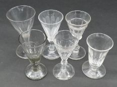 A collection of 19th century glasses. Including five petal cut conical gin glasses and a petal cut