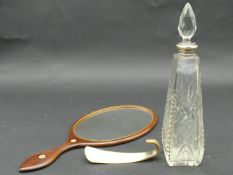 A bone inlaid dressing table mirror, a horn shoe horn and a silver collared star cut crystal
