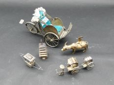 A miscellaneous collection of six Chinese white metal and Chinese silver models. Including