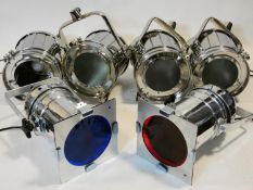 Three vintage style chrome cased spotlights on adjustable tripod stands along with three similar