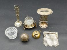 A collection of silver and white metal items. Including a silver Judaica Hvdalah candle holder, an