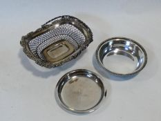 A 19th century silver plated pierced swing handled bread basket along with a silver plated dish