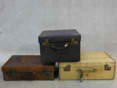 A vintage crocodile skin suitcase, a leather hat case and a vintage case with lift out tray. H.23