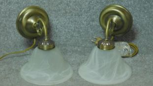 Two vintage style brass wall lights with marbled white glass shades. 20x25cm