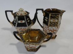 An early 20th century Japanese blue and gilt glazed coffee pot along with a matching jug and bowl.