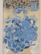 A lacquered framed and galzed antique Japanese woodblock print of a geisha in a crane design kimono,