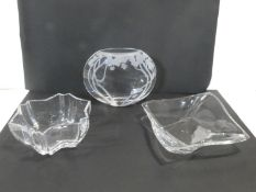 A bulbous crystal glass vase with etched foliate decoration, a crystal leaf shaped bowl and an
