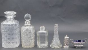 A collection of cut glass items. Including a cut glass decanter, a silver collared cut glass