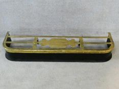 A 19th century brass and metal fire kerb fitted with central kettle stand. H.16xW.113xL.30cm