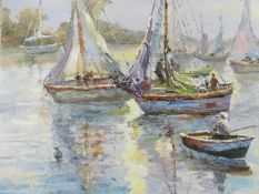 An oil on canvas of sailing boats on the water. Signed Jackson. H.51xW.61cm