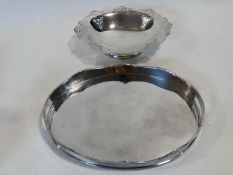 A silver plated twin handled galleried tray along with a silver plated comport with pierced