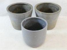 A set of three faux stoneware garden planters. 40x48cm