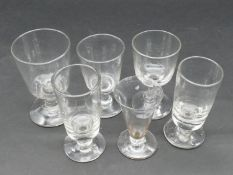 A collection of six 19th and 18th century glasses. Including two 19th century absinthe glasses, a