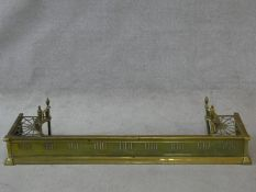 A 19th century pierced brass fender with kettle stand to each end. H.32 W.127 D.29cm