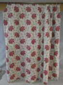 A pair of silk mixed lined curtains with stylised red floral design on a cream background. 223x175cm