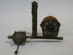 Three Tibetan Bhuddist religious items. Including a brass and copper prayer wheel, a scroll holder