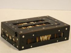 An ebonised lidded jewellery box with inlaid porcupine quills. H.5 W.17 D.11cm
