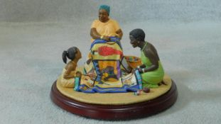 """A boxed Thomas Blackshear Ebony Visions """"The Threads that Bind"""" hand painted figure on wooden"""