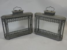 A pair of 19th century style pierced metal lanterns with glazed doors and panels. H.43xW.48xL.12cm
