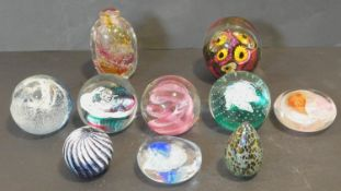 A miscellaneous collection of ten Art Glass paperweights to include signed, Isle if Wight, Caithness