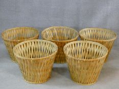 A set of five large wicker baskets. H.40 W.53 D.53cm
