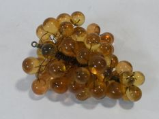 A vintage amber acrylic bunch of grapes mounted on wires. H.19xW.34xL.28cm