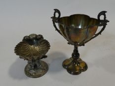 A Regency silver plated shell shaped salt on entwined dolphin base, stamped J&Co for Johnson & Co,