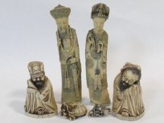 Four various Chinese moulded figures of immortals along with two similar netsukes. Stamp to base.