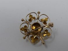An antique yellow metal, pearl and diamond set pierced floral and foliate design brooch/pendant. Set