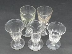 A collection of five 19th and 18th century glasses. Including a petal cut toast master's glass,