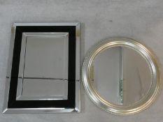An Art Deco style wall mirror and a circular silvered frame mirror. H.91 W.70cm