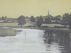 A framed and glazed limited edition print (51/151), riverscape with village in distance,