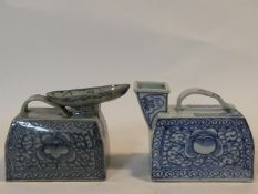 Two Chinese porcelain hand painted portable urinals with floral blue and white design. One