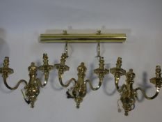 A set of three heavy solid brass Dutch style wall candelabras and a brass wall picture light. H.31cm