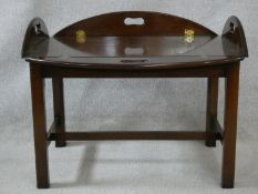 A 19th century style mahogany folding butler's tray on stand. H.48 L.93 W.68cm