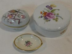 A hand painted Herend lidded pot, a porcelain and gilt metal Limoges egg and a Furstenburg dish.