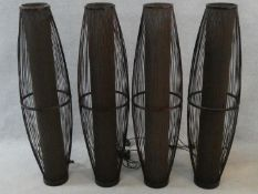 Four as new contemporary stained rattan and fabric elyptical cage lights with press switch. H.109cm