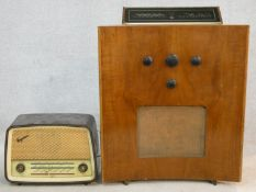 A 1930's walnut cased Murphy 188 floor standing valve radio with concave outline along with a