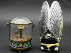 An animated vintage angel fish aquarium clock with moving fish, brass base with cloisonne enamel and