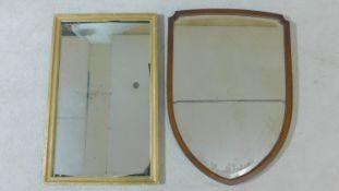 A gilt framed wall mirror and a mahogany framed shield shaped mirror. H.82xW.52cm