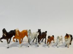 A collection of porcelain animals including four hand painted porcelain Beswick horses, makers stamp